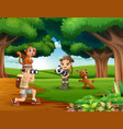 zookeeper boy and girl with animals in the jungle vector image vector image