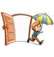 A boy with an umbrella vector image vector image