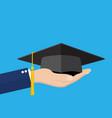 hand holding graduation cap vector image vector image