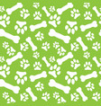 seamless pattern with white dog paw prints and vector image
