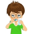 Cute little boy brushing teeth vector image