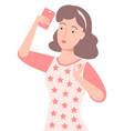 woman holding smartphone taking selfie vector image