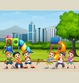happy children playing tug of war in the city park vector image