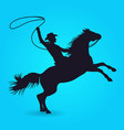 silhouette cowboy with lasso riding on horse vector image