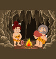 cartoon prehistoric caveman couple vector image vector image