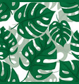 monstera seamless background tiled jungle pattern vector image vector image