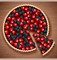 berry pie on a wooden table vector image vector image