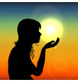 silhouette woman on sunset holding sun in hand on vector image vector image