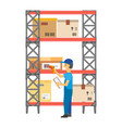 worker putting bar codes on carton boxes on rack vector image vector image