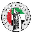 Grunge stamp with the flag and town Dubai emirate vector image vector image