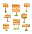 Wooden signpost in grass isolated set vector image