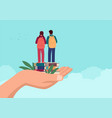 hand holding two children standing on books vector image vector image