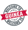 welcome to Guinea red round vintage stamp vector image vector image