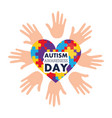 autism awareness day open hands and heart with vector image vector image