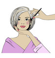 beautiful woman and makeup artist in a beauty vector image