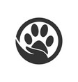 paw silhouette in circle shape and hand vector image