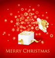 Christmas gift box with gold ribbon and flying vector image