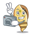 photographer sea shell mascot cartoon vector image