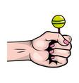 pop art hand with lollipop cartoon vector image vector image