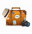 vintage travel suitcase with tickers vector image vector image
