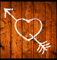 arrow piercing heart on realistic wood planks vector image