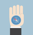 Businessman hand holding a compass that points to vector image vector image