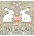 greetings card with easter eggs and two rabbits vector image