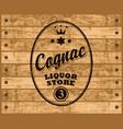 cognac label on wooden background vector image vector image