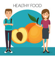young couple with peach healthy food vector image vector image