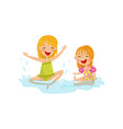 cheerful kids making water splashes two little vector image vector image