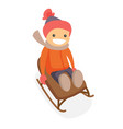 happy caucasian white boy enjoying a sleigh ride vector image