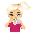 Cute little girl brushing teeth vector image