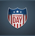 veterans day text on realistic emblem vector image