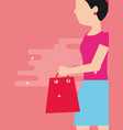 woman holding shopping bag walking vector image vector image