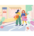 two girls go from store with shopping bags vector image