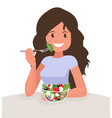 happy woman is eating a salad vegetarian vector image vector image