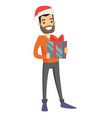 young caucasian white man holding christmas gift vector image vector image