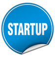 startup round blue sticker isolated on white vector image vector image