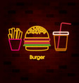french fries burger and drink on neon sign on vector image