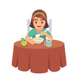 little girl eating smiling hungry toddler sits vector image