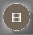reel of film sign white icon on brown vector image vector image