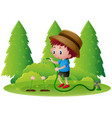 boy watering flowers in the garden vector image vector image