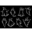 Set of Halloween ghosts on a blackboard vector image