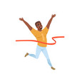 happy afro-american man crossing red finish tape vector image vector image