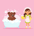 girl cleaning her bear toy vector image