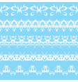 Set of white lace edging ornaments on a blue backg