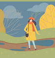 young woman wearing warm clothes standing on vector image vector image