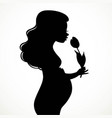 silhouette of a beautiful young pregnant woman vector image vector image