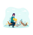 young female volunteer feeding dogs vector image vector image