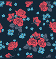 red roses and myosotis flowers on dark blue